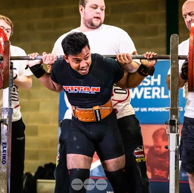 A student lifting weights in a competition